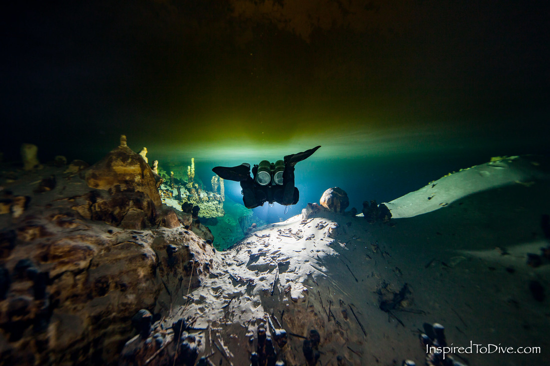 Cave diver in tannic dome in Naharon in Mexico