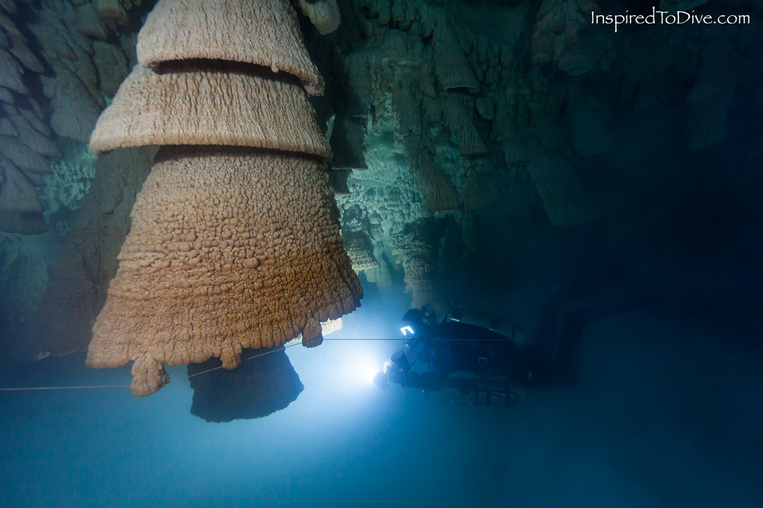 A cave diver with the Hell's Bells formations at Cenote Zapote in Mexico