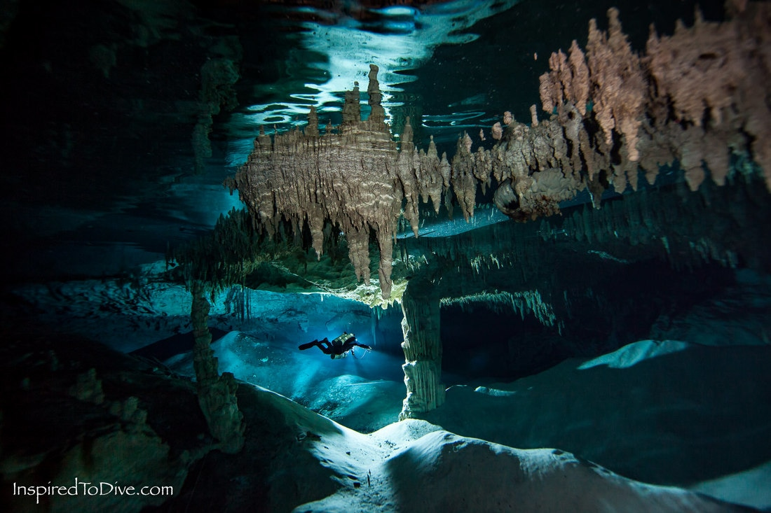A cave diver travels through the shallow passages of Nohoch Nah Chich