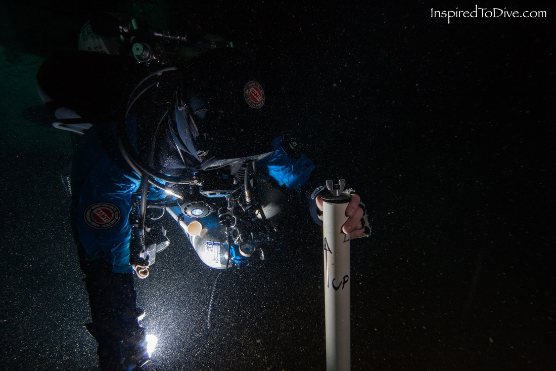 Cave diver collecting a sediment core in a cave in Mexico