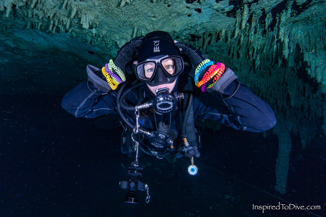 Cave diver collecting plastic bangles from a cave in Mexico