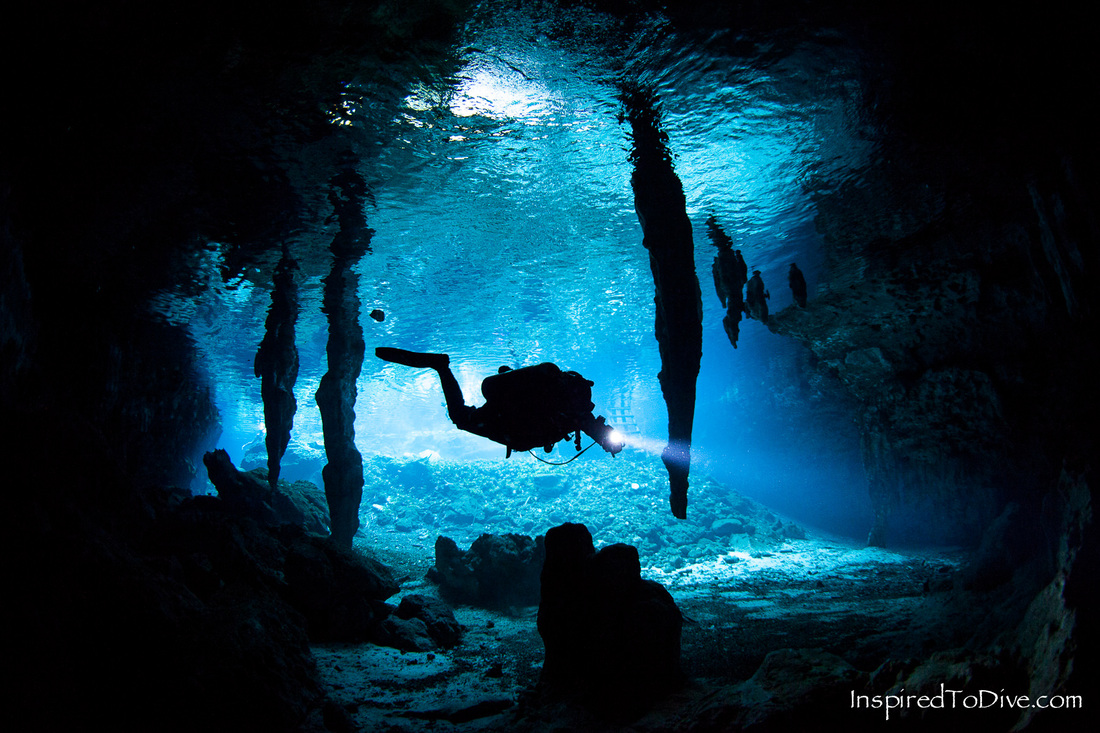 Cave diver with speleothems in Grand Cenote in the Riviera Maya in Mexico