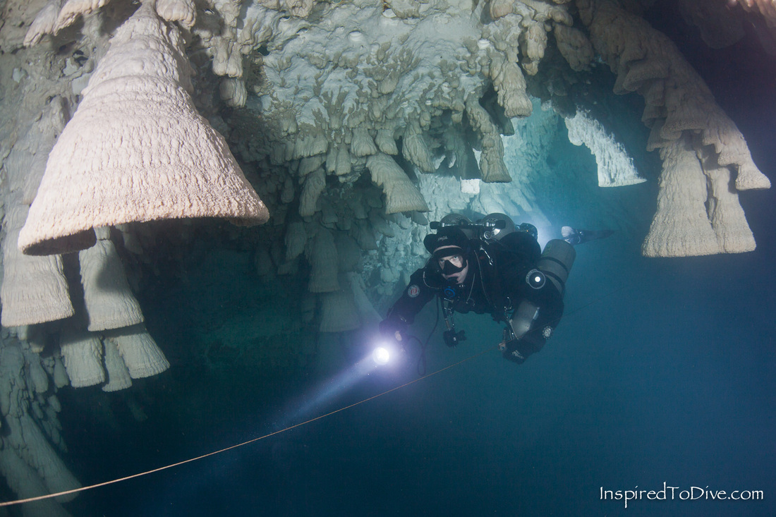 Cave diver with bell formations in Cenote Zapote near Cancun in Mexico