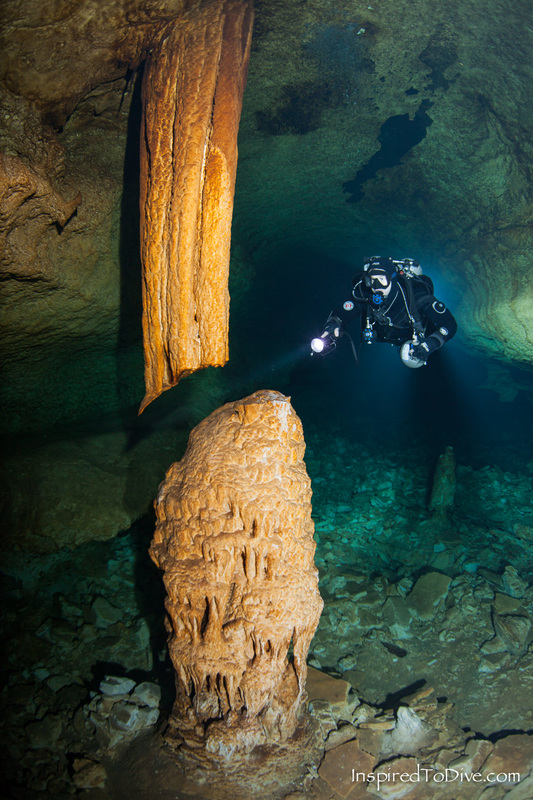 Cave diver with gigantic speleothem in Cenote Camilo in Mexico